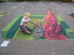 3D Street Painting - Chess with the Dalai Lama by Tracy Lee Stum