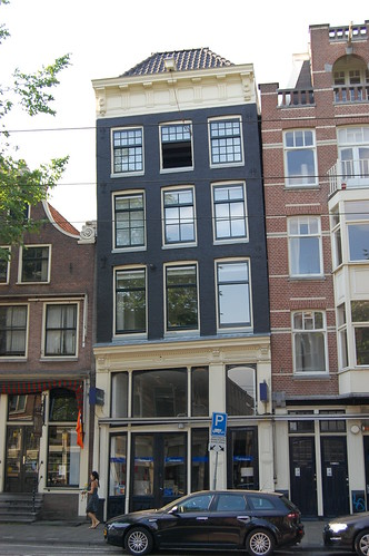 one of many leaning buildings in amsterdam