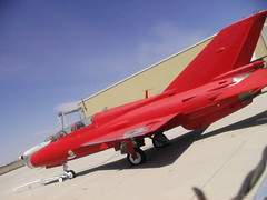 Red 2 seat MiG in California n121tj MiG-21U (Socal Photography) Tags: california test classic abandoned airplane fighter 21 aircraft flight historic vietnam forgotten prototype russian warbird mig spaceport eval mig21 mojaveairport foriegn fishbed flighttest n121tj