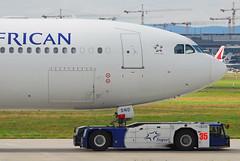 South African Airways Airbus A340-642 ZS-SND (23350) (Thomas Becker) Tags: tractor plane germany airplane geotagged deutschland airport nikon hessen frankfurt aircraft airbus d200 tamron flugzeug saa spotting fra a340 southafrican 200500 fraport rheinmain staralliance a340600 southafricanairways noseshot eddf a340642 aerotagged luftfahrzeug 071103 aero:man=airbus aero:model=a340 aero:series=600 goldhofer aero:airport=eddf zssnd 080824 131003 aero:airline=saa towbarless ast1 vorfeldaufsicht aviationphoto msn531 fwwcx aerotug geo:lat=50039323 geo:lon=8596877 aero:tail=zssnd