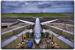 Feeding The Beast!!! (Ryan Eng) Tags: sky tarmac plane airplane hawaii interestingness airport cloudy oahu symmetry explore honolulu frontpage runway dri hdr boarding unitedairlines hnl sigma1020mm nikond90 ryaneng ryausting