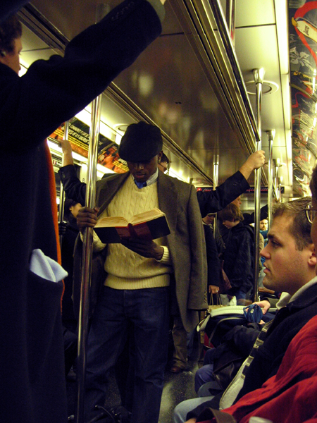 Reading on the Subway (Click to enlarge)