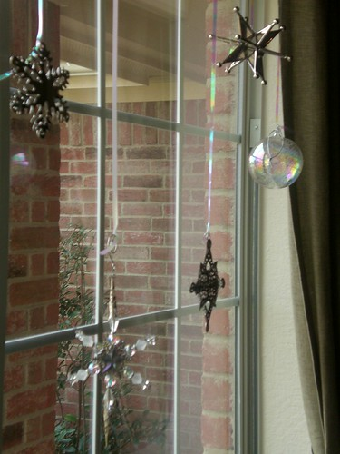 Breakable ornaments hung in the window.