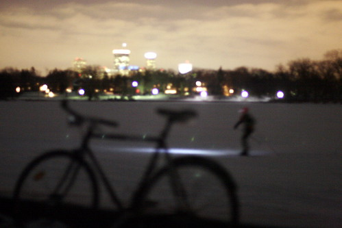 Minneapolis skyline, cross country skiier, Lake of the Isles
