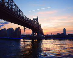 enlighting (Tattooed JJ) Tags: nyc bridge red ny water sunrise river glow pentax manhattan east 59th jjp k200d