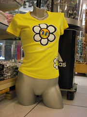 mannequin with slit (jbiddulph.com) Tags: woman flower mannequin yellow shop headless body fake tshirt plastic vagina armless mallorca manequin manekin slit mannekin legless