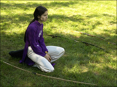 Archer getting ready for the final shoot (NaPix -- (Time out)) Tags: woman canada concentration vietnamese purple vietnam explore bow arrow archery potrait themoulinrouge firstquality explorefrontpage odi explore30 thewayofthebow kyudoarchery thegardenofzen thisiszen napix vietnamesenationaldress bowandarrowsport hanoiartistnguyncttng paddedcoatquot hanoiartistnguyncttngredesignedthisgownasadressin1930