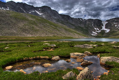 Summit Lake Park, Colorado (Thad Roan - Bridgepix) Tags: park mountain lake snow reflection ice nature water grass clouds landscape colorado rocks explore rockymountains wildflowers soe mountevans summitlake golddragon 200807 dragongold