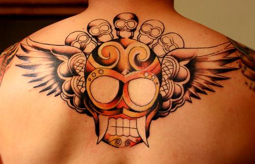skull wings tattoo