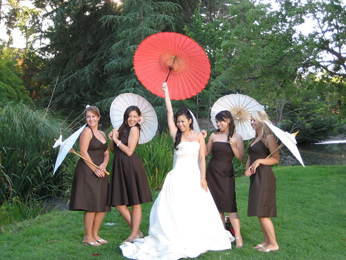 A fun bridal party photo with parasols.