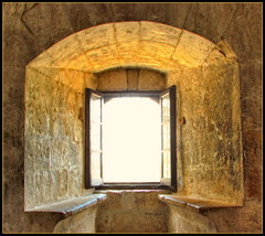 Castle Window (Mike G. K.) Tags: lighting light castle window yellow stone wall architecture gold golden ancient exposure glow bright fort seat cyprus symmetry walls stronghold shining middleages hdr blend blending kolossi photomatix limasol lemesos 3exp theperfectphotographer anticando castlespalacesmanorhousesstatelyhomescottages mikegk:gettyimages=submitted