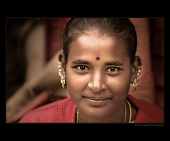 LADY of Madiwala market (Light and Life -Murali ) Tags: india face lady happy bangalore ornaments glowing karnataka bws madiwala bws20sep2008madiwala