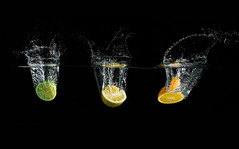 splash en trio (Dan. D.) Tags: light orange black water fruit canon waterdrop flash 5d citrus lime splash 580ex strob strobist eldano hawaalrayyanfav