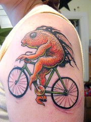a fish needs a bicycle (Rippingoffthestars) Tags: auto portrait fish selfportrait me bike tattoo self canon autoportrait provincetown capecod powershot ptown canonpowershot digitalelph sd1100is canonpowershotsd1100isdigitalelph