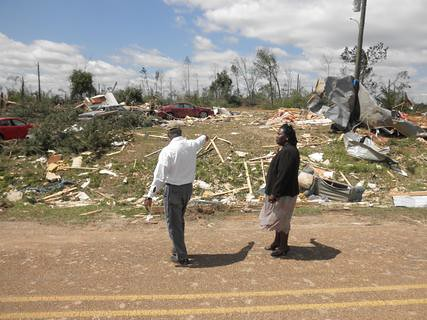 State Director Trina N. George inspects damages in Holmes County after a tornado.