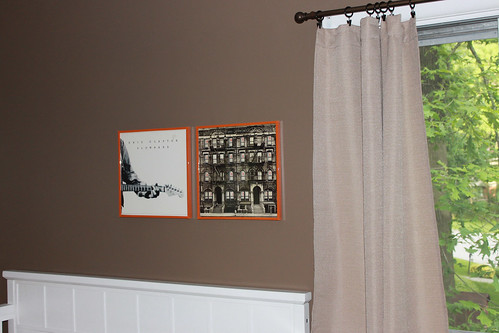 Framed album covers in Landon's room by you.