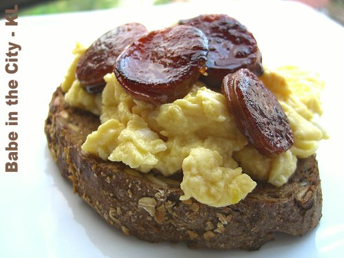 Scrambled Eggs Topped With Chorizo on Homemade Multiseeds Bread