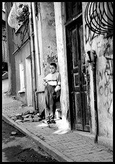 ...beklerken... (desalinado) Tags: street door boy window blackwhite child istanbul ocuk sokak balat kap mywinners aplusphoto theperfectphotographer 3godeyes0508