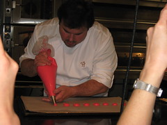 Pierre Hermé: Piping the macaron biscuit batter for Macaron Ispahan
