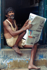 (jaroslavd) Tags: street india man newspaper doorway madurai tamilnadu