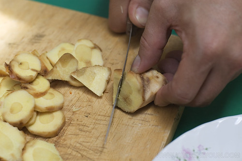 Slicing ginger.