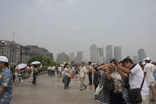 The Bund is where everyone hangs out. You can see Old Colonial Shanghai on one side. And sleek modern Shanghai across the river.