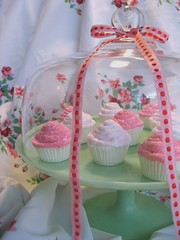 sparkle pink rosey cupcakes (Pinks & Needles (used to be Gigi & Big Red)) Tags: red roses stilllife art cakes glitter vintage cupcakes linen fake sparkle bakery faux ribbon jadite pinks pretend inedible fireking cakeplatter glassdome pedastol polksdots gigiminor gigiandbigred gigibigred fauxdough