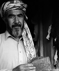 The Karakul Seller (From Afghanistan With Love) Tags: old afghanistan hat digital canon eos rebel kiss muslim culture karakul turban seller shopkeeper zeerak xti safrang hamesha javaid