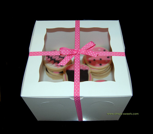 box and pink and black birthday cookies