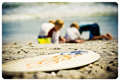 Beach boys bokeh (Lynne Rigby) Tags: beach boys water fire sand yinyang skimboard nsbbeach frontpagewoot
