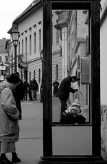 (B. Beeson) Tags: city blackandwhite woman baby one solitude hungary alone phonebooth budapest streetphotography lone