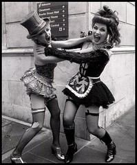 rocky relationship (mugley) Tags: street costumes girls portrait blackandwhite bw film stockings wall corner 35mm canon actors women highheels boots grain magenta australia melbourne columbia victoria strangle gloves tophat scream rockyhorror fishnets torn epson cropped cbd a1 135 suspenders performers choke shout actresses lonsdalest v700 macophot comedytheatre exhibitionst pulled1stop macocube400c 28mmf2fd tamsincarroll sharonmillerchip