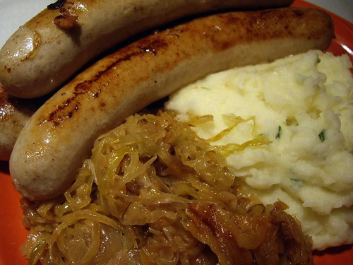 Fried Sausages with Caramelized Onions and Kraut and Mashed Potatoes
