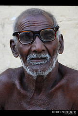 What to say?? (Smevin Paul - Thrisookaran !! www.smevin.com) Tags: life old portrait india man black glass face paul sad skin expression poor tamil tamilnadu begger nadu wrinkled mustash  smevin d40x malayalikoottam smevins thrisookaran