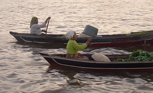 women in klotok boats, kuin river, banjarmasin