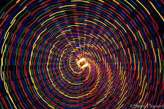 Spiral Light (Steve Hopson) Tags: christmas nightphotography usa austin spiral lights us vanishingpoint nikon texas nightlights nightshot spirals christmastree christmaslights austintexas wormhole merrychristmas doublehelix zilkerpark zilkertree trailoflights concentriccircles vanishingpoints lighttunnel d700 spirallight nestedcircles nikond700 christmas2008 austintrailoflights christmasspiral