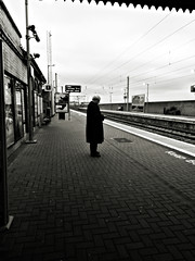 Waiting 4 transport (Sator Arepo) Tags: blackandwhite bw howth dublin station train vanishingpoint reflex waiting transport platform olympus passenger zuiko transporter e330 uro 714mm