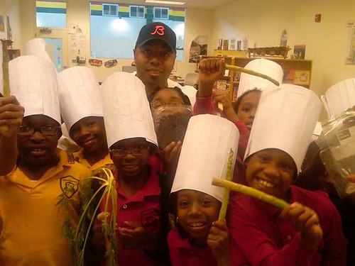 Students at Chicago's Kwame Nkrumah Academy pose with Real Men Cook's Marvin Brown during a recent Chefs Move to Schools event.