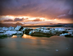 Jkulsrln - Iceland (tigric (Ana Stefanovi)) Tags: travel blue autumn winter sunset vacation sky panorama lake cold reflection ice nature water beautiful clouds landscape iceland amazing nikon paradise peace view earth joy dream dramatic paisaje september glacier harmony iceberg paysage route1 jokulsarlon glacierlagoon breiamerkurjkull flickrsfinestimages1 flickrsfinestimages2