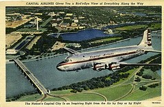 Capital Airlines DC4 postcard, over the George Washington Parkying with the National Mall in the distance