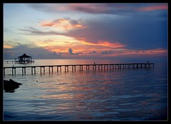 long pier sunset (shaney442) Tags: sunset sky west reflection water beautiful clouds bay pier dock waves alabama boathouse mobilebay fortmorgan bonsecourbay