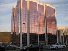 Shiny office tower (visual guy) Tags: urban 15fav canada tower glass clouds canon newfoundland reflections office downtown cityscapes stjohns 2792 interestingness3 views1000 powershots5