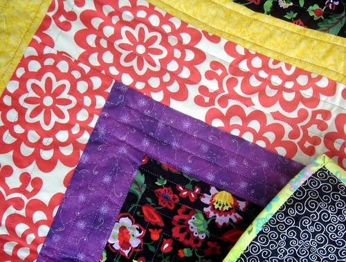 bright quilt detail with back and border