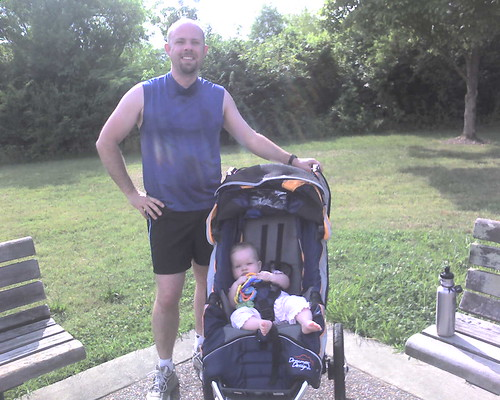 8 mos - Huz: hot and sweaty after a run. Claire: chillin' in the jogging stroller