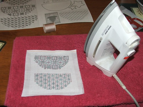 Iron on the interfacing on the reverse side of your stitching