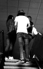 The Escalator (victoria.anne) Tags: blackandwhite canada winnipeg escalator teens sneakers jeans 2008 tightpants themall emokids