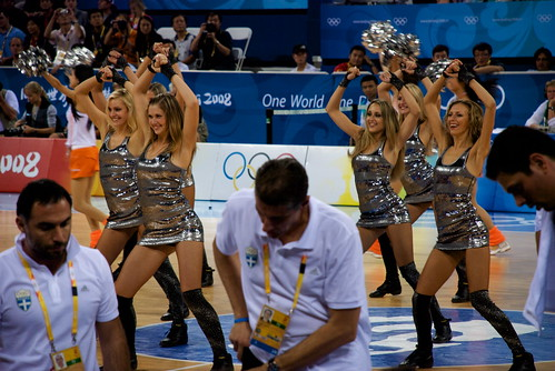 The Vegas Hooker Cheerleaders strut their stuff. The poor Greeks are too focused on strategy to watch.