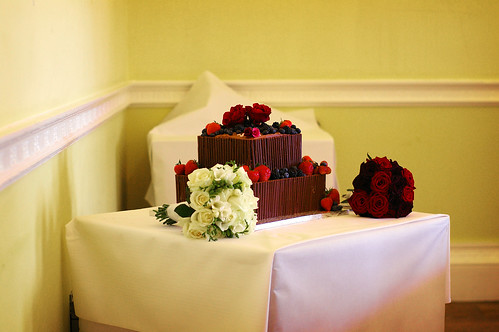 A truly lovely chocolate wedding cake The red roses are wonderful accents
