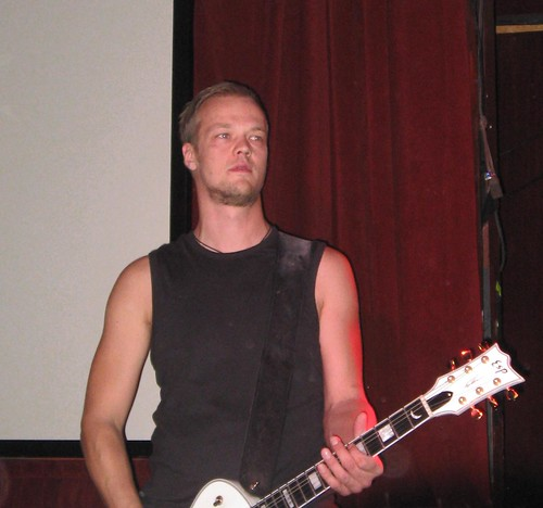 Tomi Koivusaari on guitar