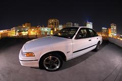 vic7 (cvpi_gt) Tags: urban white ford rooftop car night sedan lights downtown garage parking wheels platform police victoria fisheye crown mustang bullitt panther interceptor cvpi